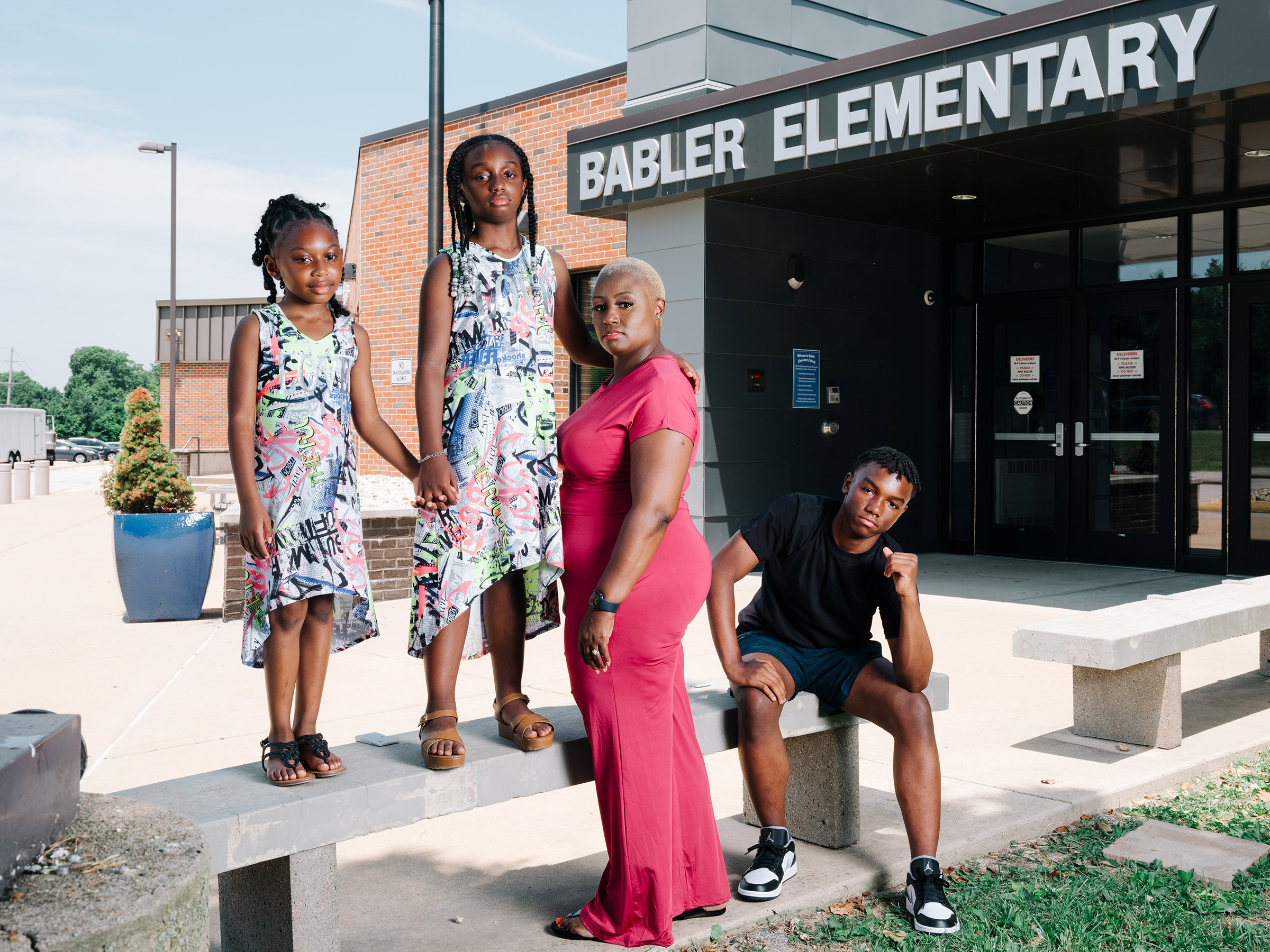 If we can't have these hard conversations, how can we possibly expect our children to?  Shemia Reese with her family at Babler Elementary in Glencoe, Mo., on June 18.