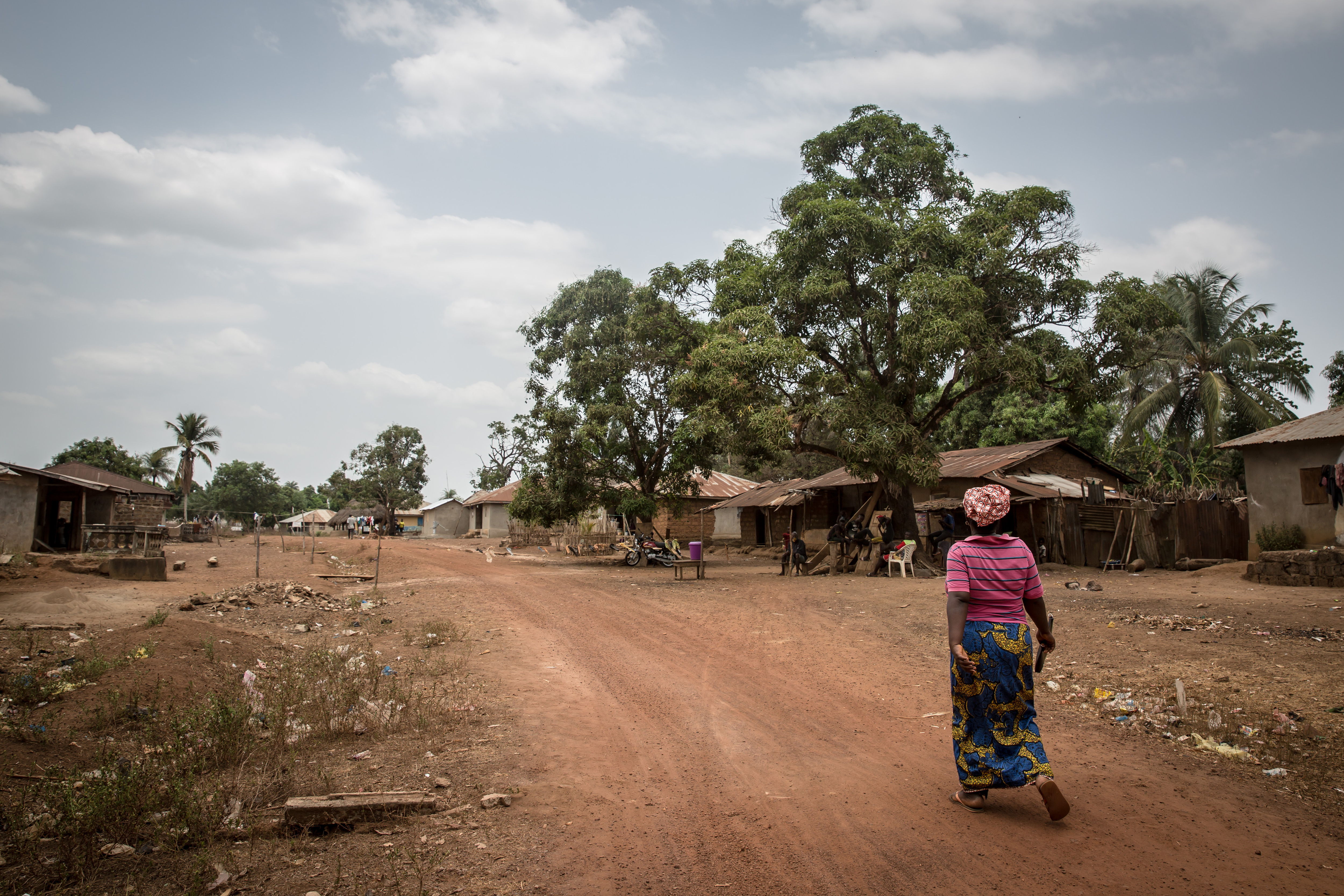 A woman approaches a community-manned checkpoint in Mafaray, Sierra Leone on April 1, 2021.