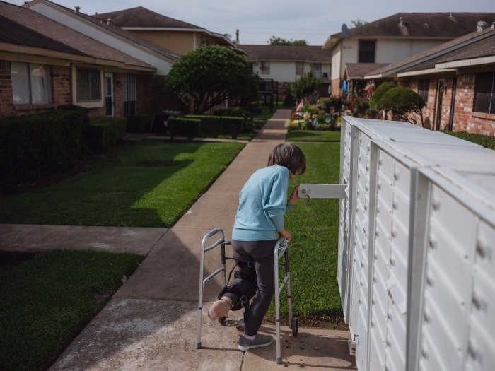 Pasadena, Texas - June 1, 2021:Nancy Thompson, 72, was seen walking to check her mail from her home in Pasadena, Texas on June 1, 2021. Thompson, an elderly person recovering from a surgical procedure and a victim of repeated falls, received assistance from CAPABLE where they retrofitted her home and provided tools to help her live more independently. Photo: Christopher Lee for TIME