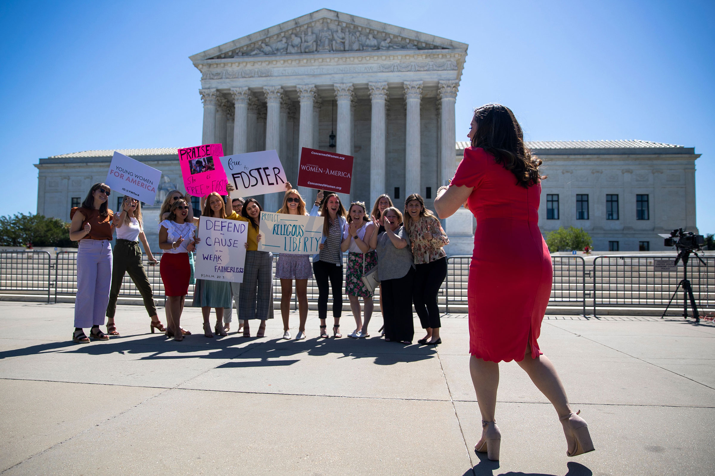 People stand in front of the Supreme Court in Washington, DC on June 17, 2021.