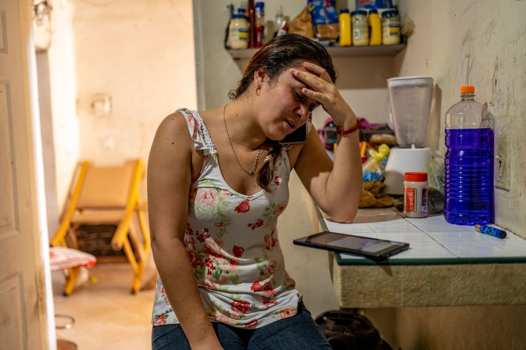 Gabriela Fajardo speaks on the phone before beginning her class at her home in Matamoros, Mexico, on May 25, 2021. Fajardo, a teacher, is also one of about 4,600 people who do not qualify for the Biden Administration's  phase 2  unwinding of the Trump Administration's Migrant Protection Protocols.