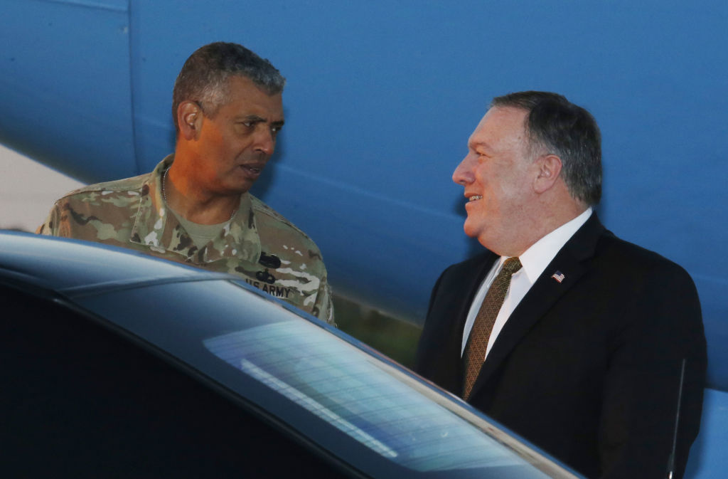 U.S. Secretary of State Mike Pompeo talks with U.S. General Vincent K. Brooks, commander of United States Forces Korea, upon his arrival at Osan Air Base in Pyeongtaek on October 7, 2018 in Seoul, South Korea.