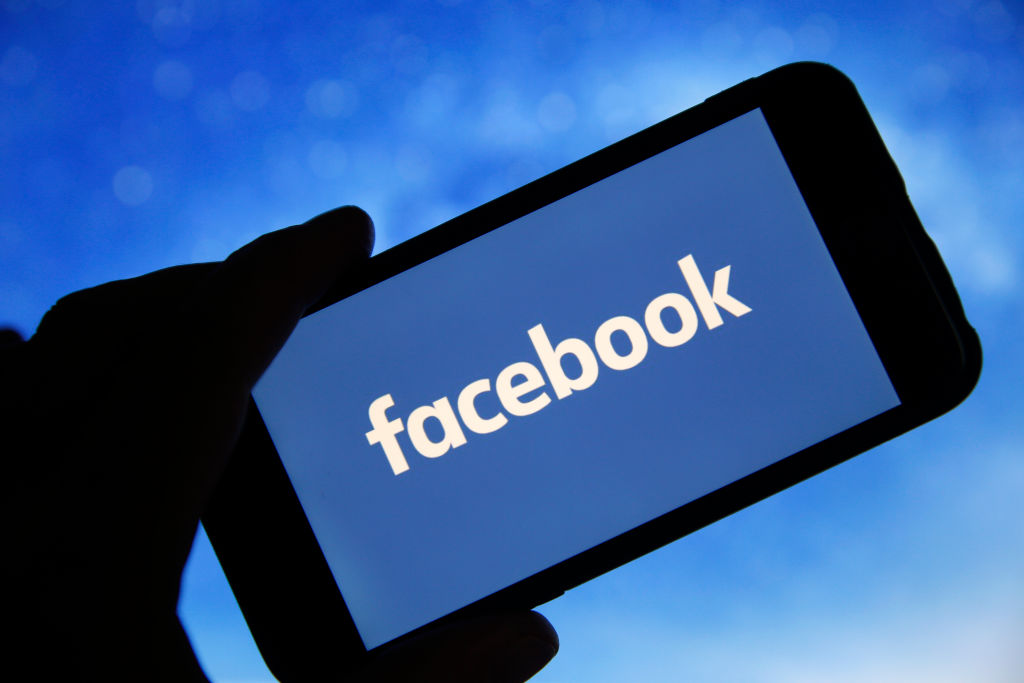 In this photo illustration the Facebook logo is seen on the screen of an iPhone on January 31, 2019 in Paris, France.