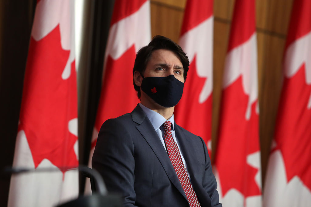 Justin Trudeau, Canada's prime minister, listens during a news conference in Ottawa, Ontario, Canada, on March 19, 2021.