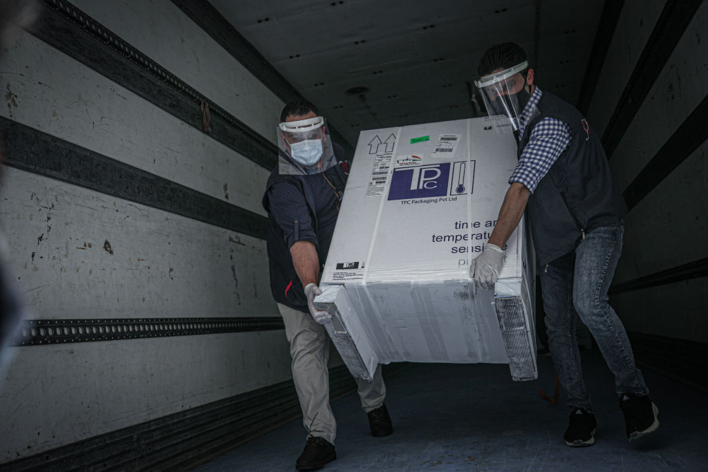 Health workers receive 53,800 doses of coronavirus vaccines, sent through the World Health Organisation's COVAX program, in Idlib, Syria, on April 21, 2021.