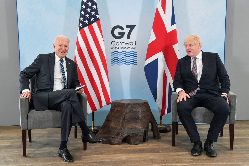 CARBIS BAY, ENGLAND - JUNE 10:  Britain's Prime Minister Boris Johnson speaks with U.S. President Joe Biden during their meeting, ahead of the G7 summit, at Carbis Bay Hotel, on June 10, 2021 near St Ives, England. UK Prime Minister, Boris Johnson, will host leaders from the USA, Japan, Germany, France, Italy and Canada at the G7 Summit that begins on Friday, June 11 2021. (Photo by Toby Melville - WPA Pool/Getty Images)