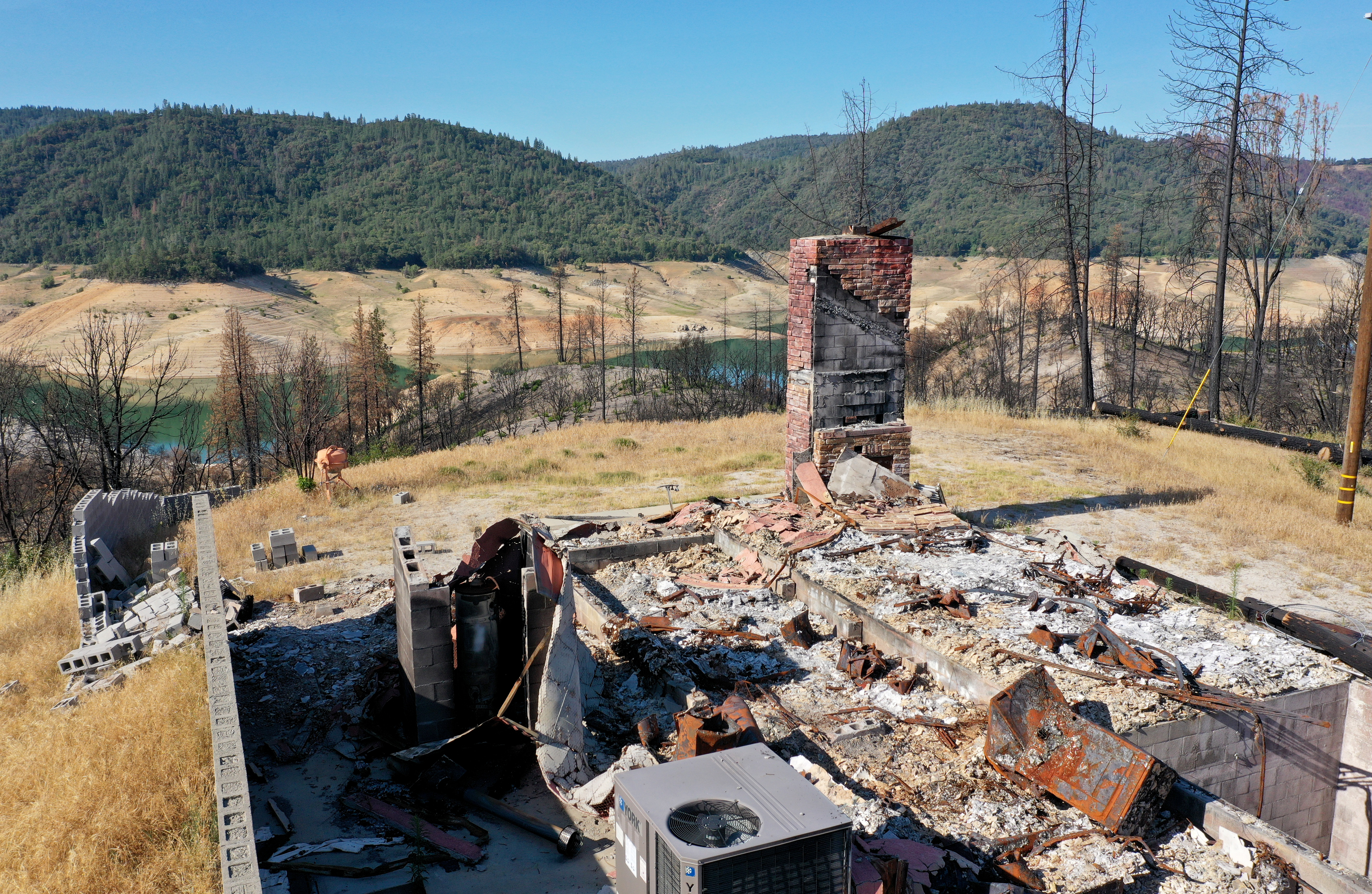 The ruins of a home hit by a recent wildfire in Oroville, Calif.