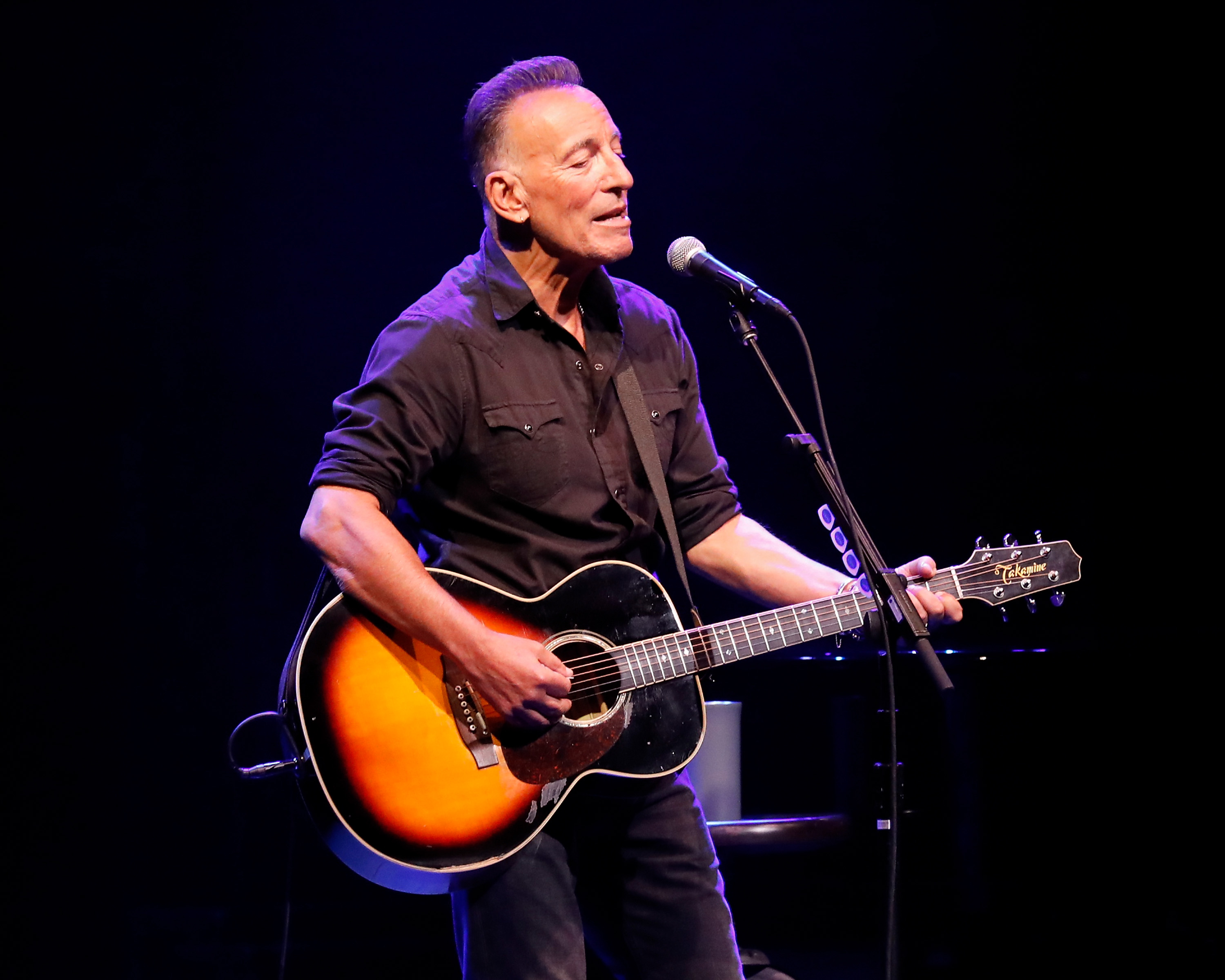 Bruce Springsteen performs during reopening night of  Springsteen on Broadway  for a full-capacity, vaccinated audience at St. James Theatre on June 26, 2021 in New York City.