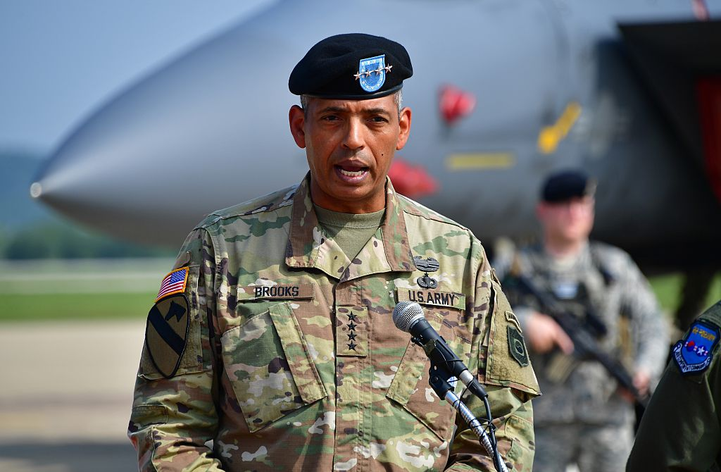 US General Vincent K. Brooks (R), then Commander of the United Nations Command, Combined Forces Command and United States Forces Korea, speaks during a press briefing on the flight by US B-1B Lancer over South Korea at the Osan Air Base in Pyeongtaek on September 13, 2016.