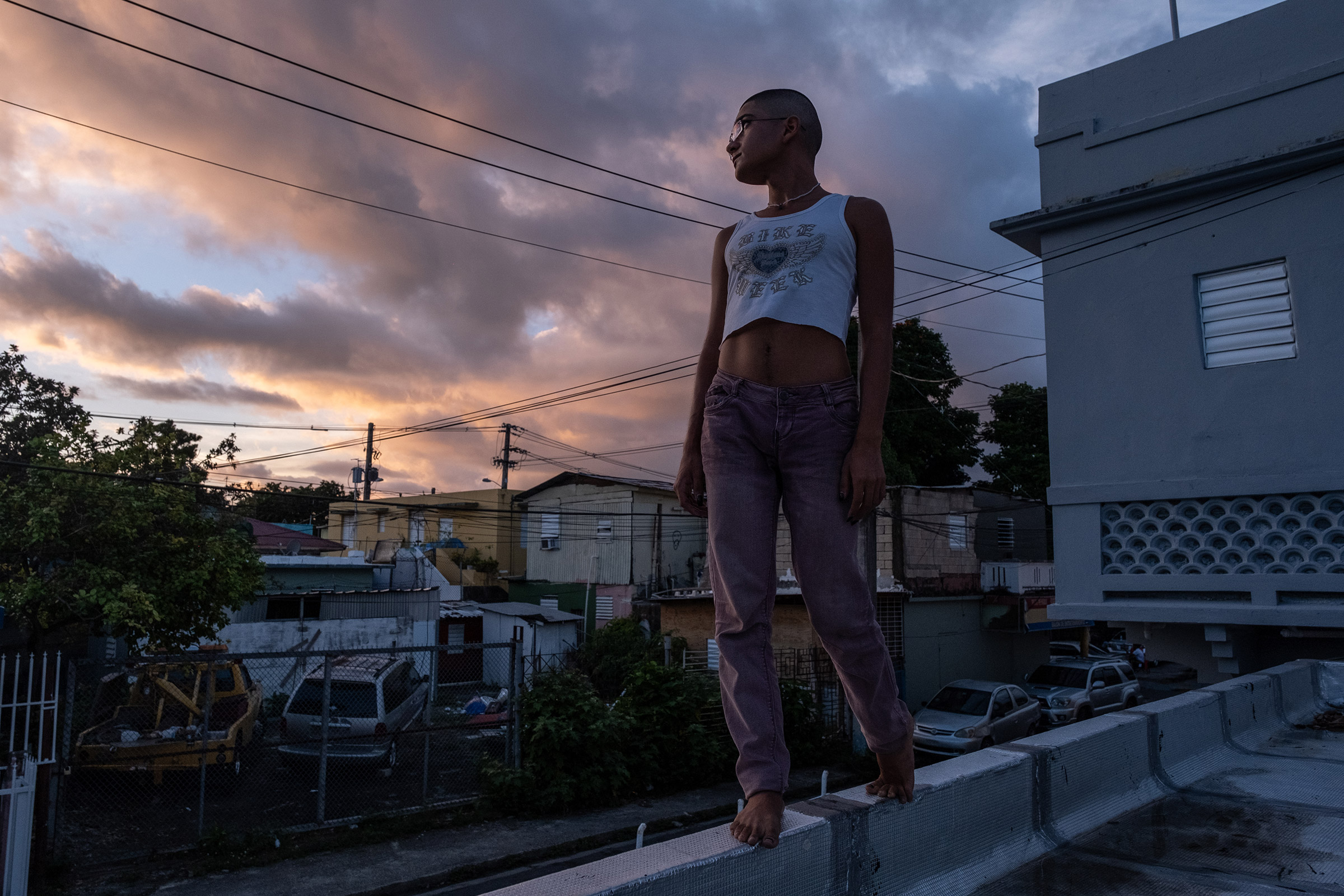 """Beibijavi, 22, poses for a portrait on the rooftop of their neighbors' apartment in Rio Piedras, San Juan, Puerto Rico. """"We deserve love, support, stability, and safety. We transcend our intersections,  Beibijavi tells TIME.  We are infinite."""""""