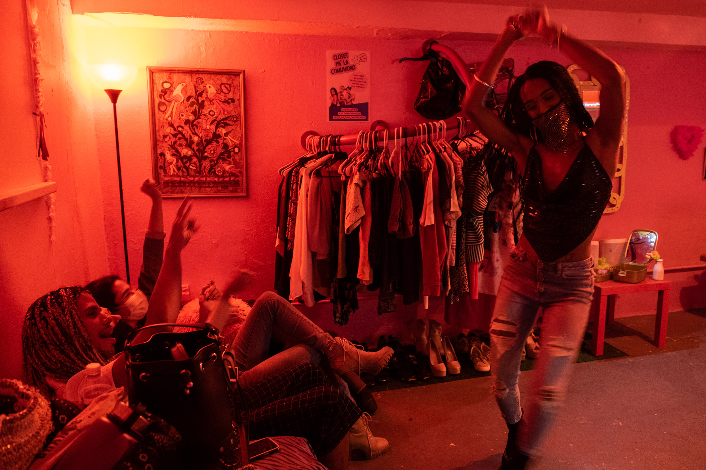 Teresa dances during House of Grace's holiday dinner in the queer bar Loverbar in Rio Piedras, San Juan, Puerto Rico.