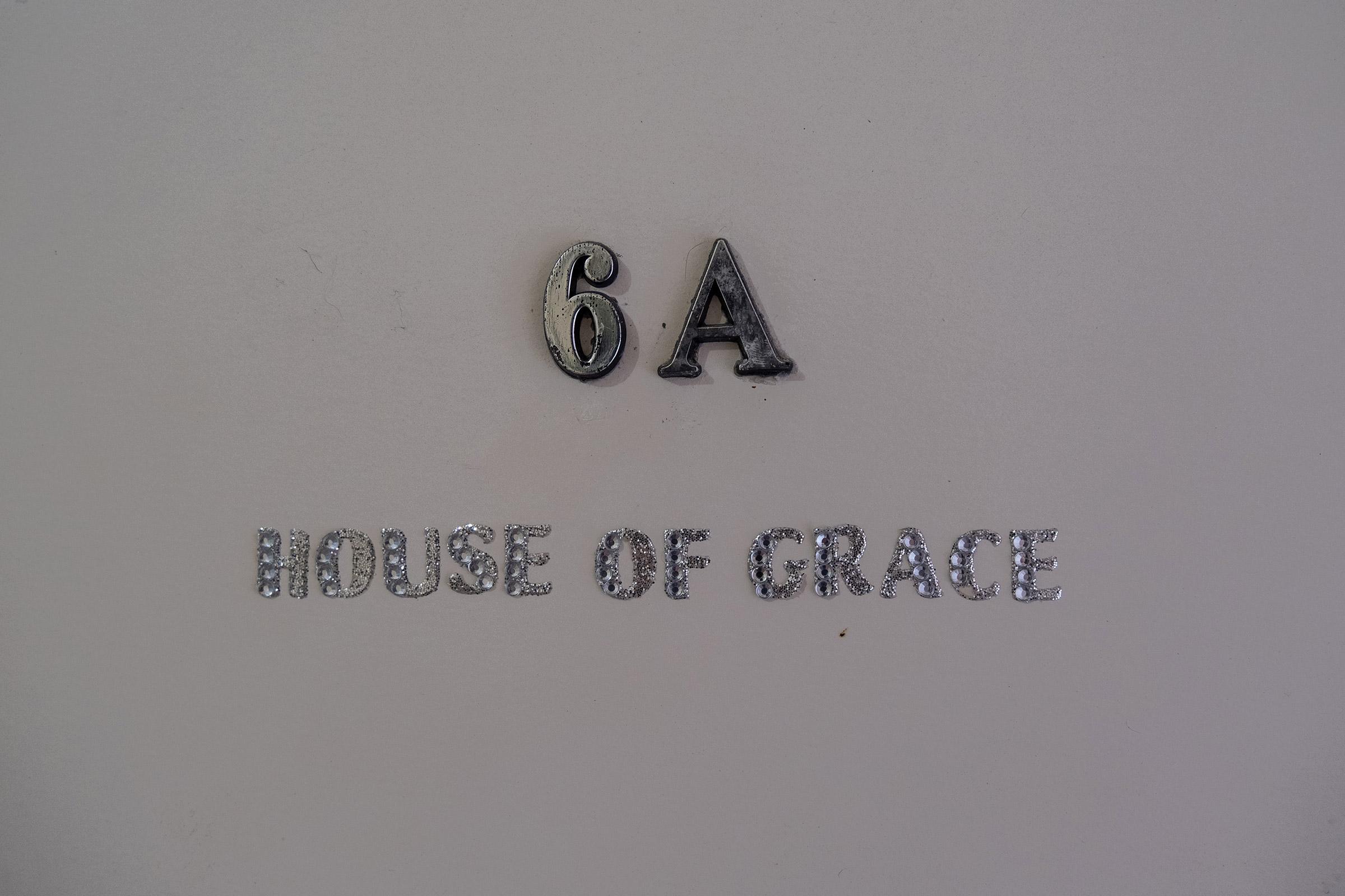 """María José's apartment door reads """"House of Grace"""" in Rio Piedras, San Juan, Puerto Rico."""
