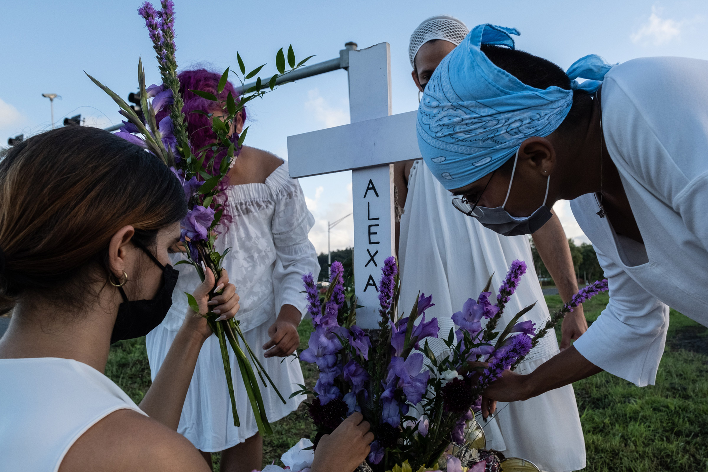 Members of House of Grace pay respects to Alexa Negrón Luciano, a transgender woman who was murdered in February 2020, on the site of a makeshift grave dedicated to her in Toa Baja, Puerto Rico.