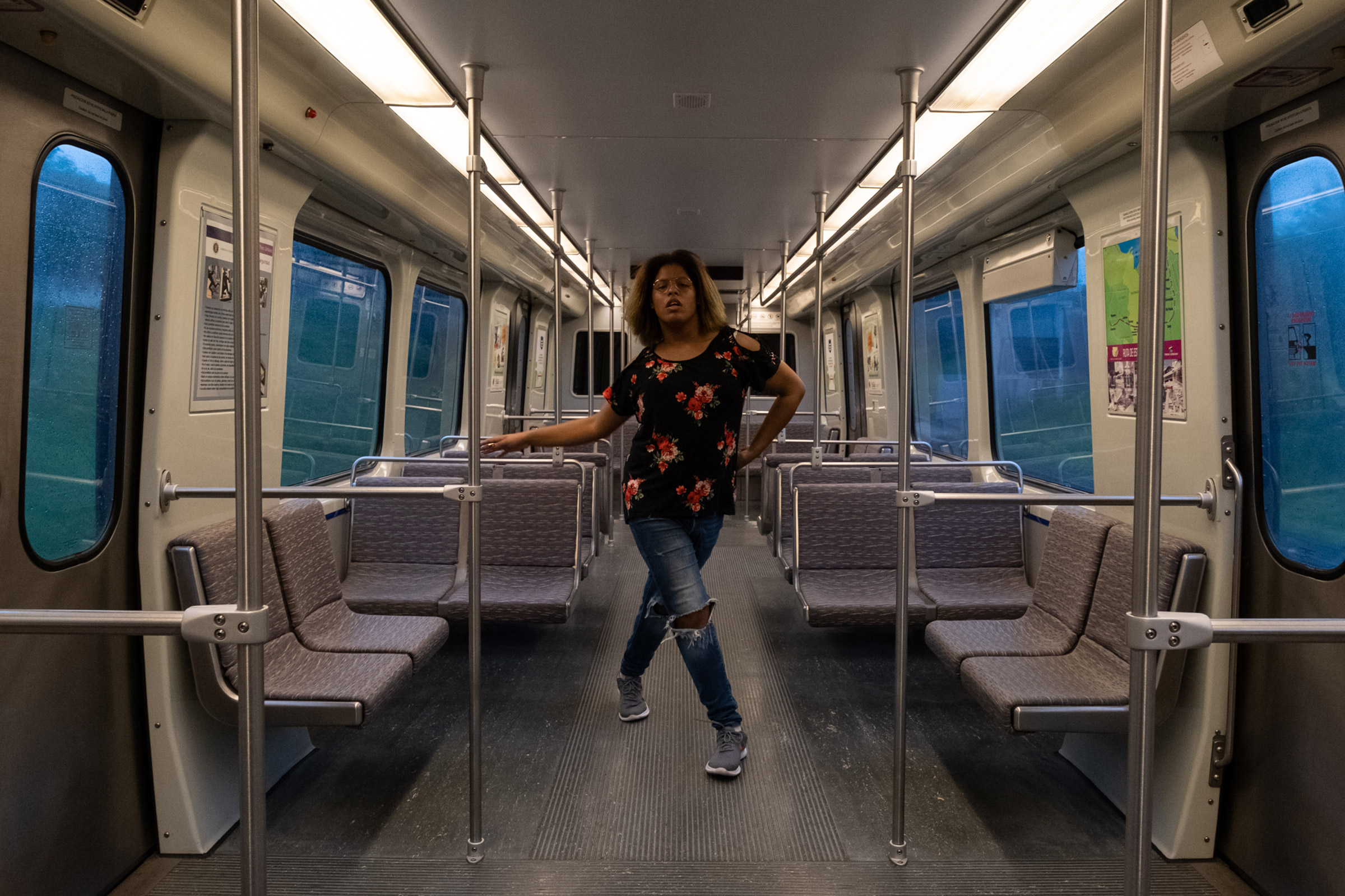 LeQueen, 21, vogues on the train she takes on a daily basis to commute to work and other places around San Juan, Puerto Rico.