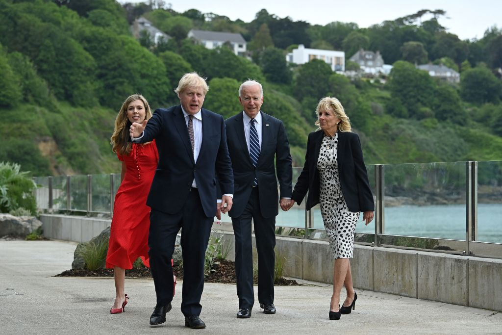 Britain's Prime Minister Boris Johnson and his wife Carrie Johnson walk with US President Joe Biden and First Lady Jill Biden prior to a bi-lateral meeting at Carbis Bay, Cornwall on June 10, 2021.