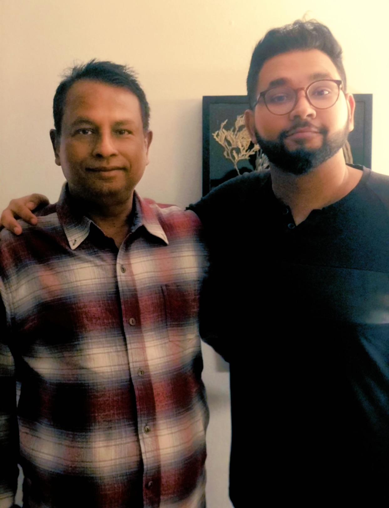 Koushik Paul, right, and his father, Krishna Paul