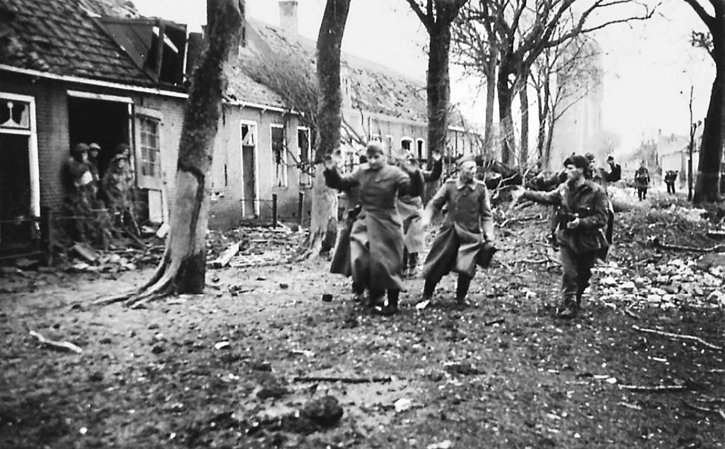 Maurice Latimer, on right, with captured prisoners from the Westkapelle lighthouse, Walcheren, November 1, 1944