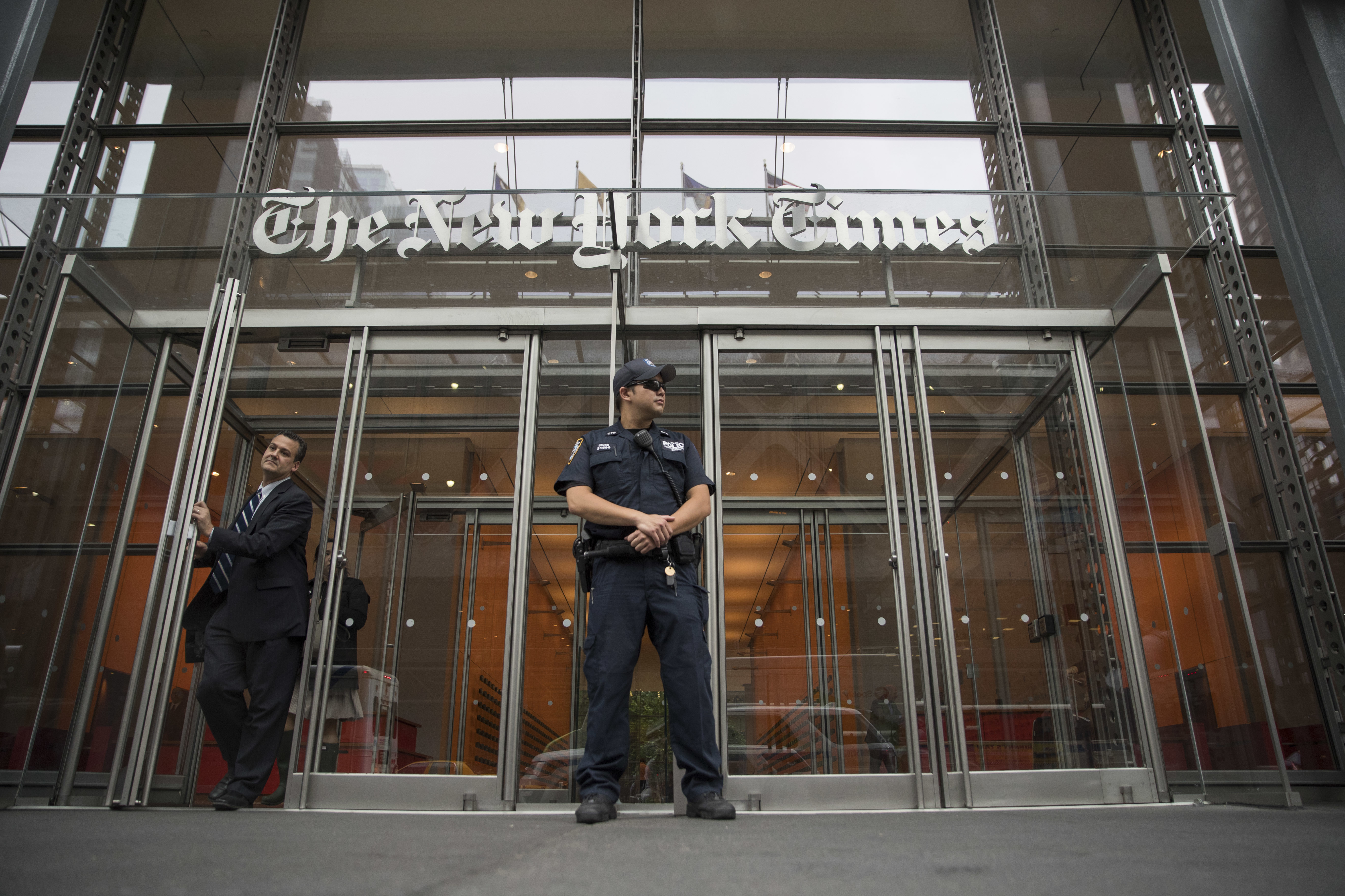 A police officer stands outside The New York Times building in New York, on June 28, 2018.