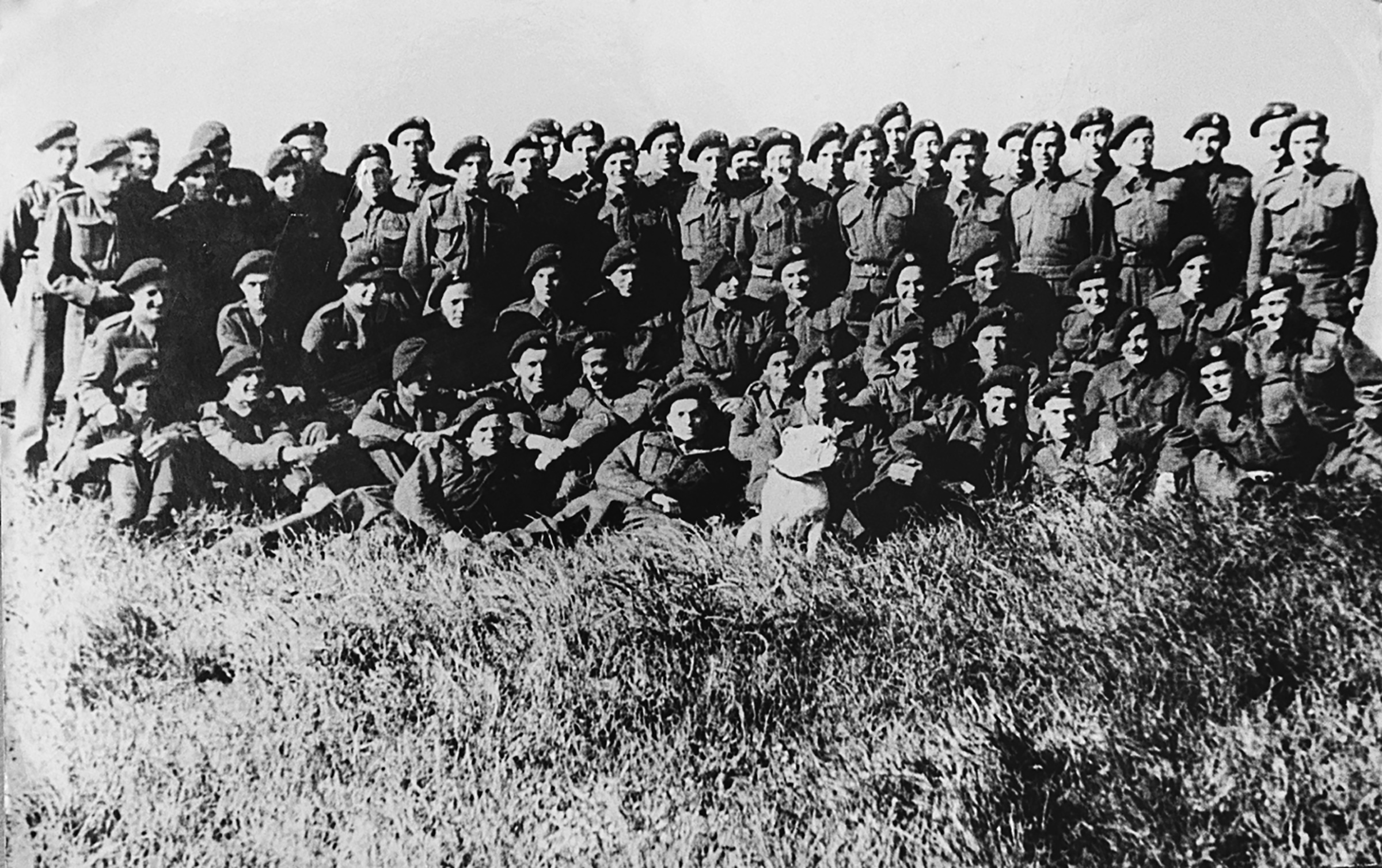 X Troop at Aberdovey, 1943. Peter Masters is in the back row, second from the left; Colin Anson is in the second row from the back, twelfth from the left; Manfred Gans is in the third row from the back, third from the right; and Bryan Hilton- Jones is in the front row, just to the left of Bully.