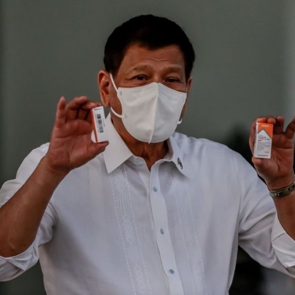 Philippine President Rodrigo Duterte shows boxes of Sinovac COVID-19 vaccines in Manila, the Philippines on March 29, 2021.                                           The Philippines on Monday received the first batch of the Sinovac COVID-19 vaccines its government has purchased from China.