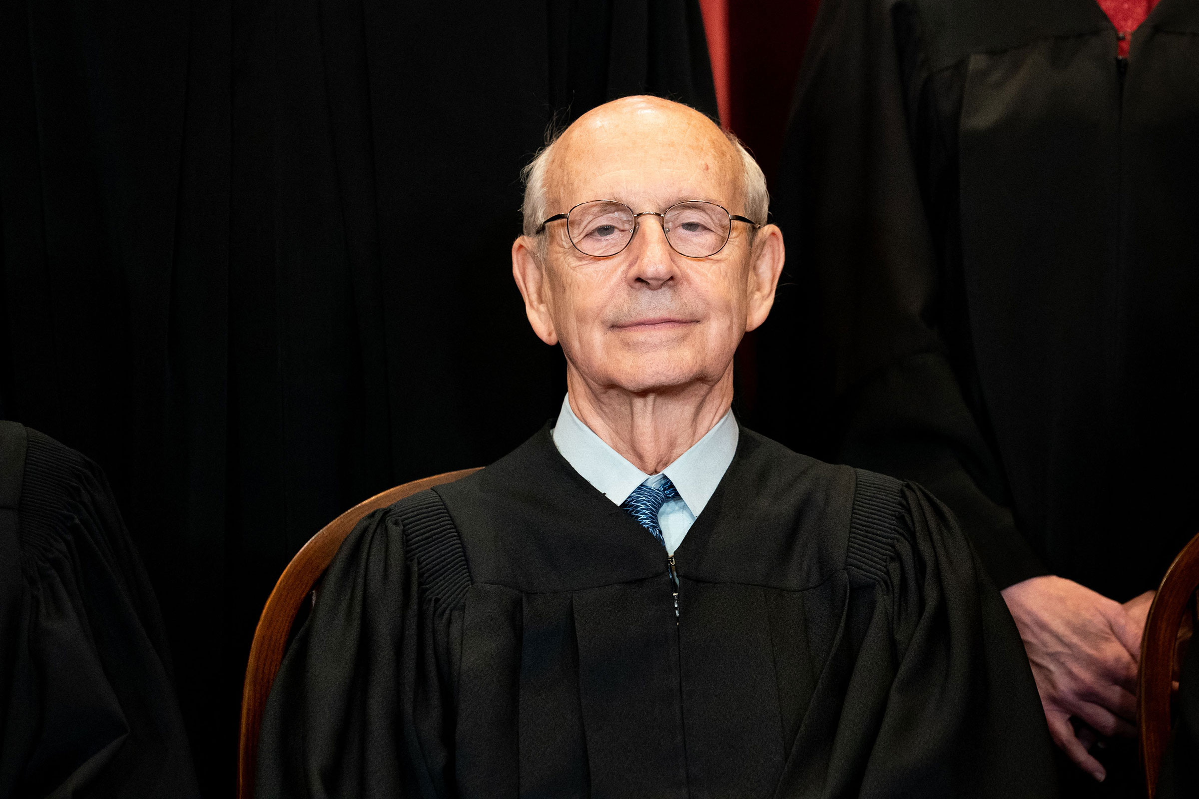 Associate Justice Stephen Breyer sits during a group photo of the Justices at the Supreme Court in Washington on April 23, 2021.