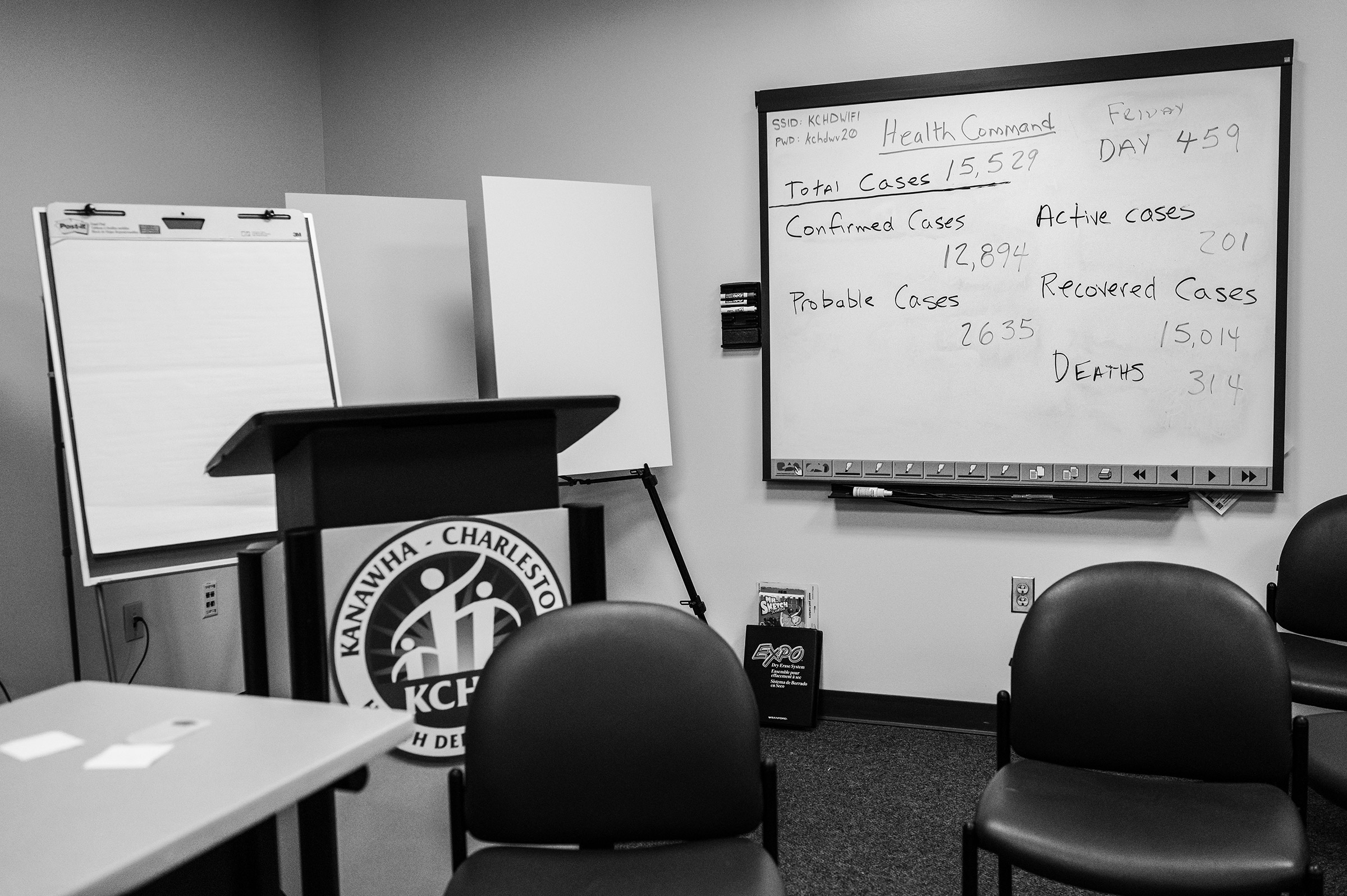 A dry erase board with the county's Covid-19 statistics hangs in the Kanawha-Charleston Health Department in Charleston on June 4, 2021.