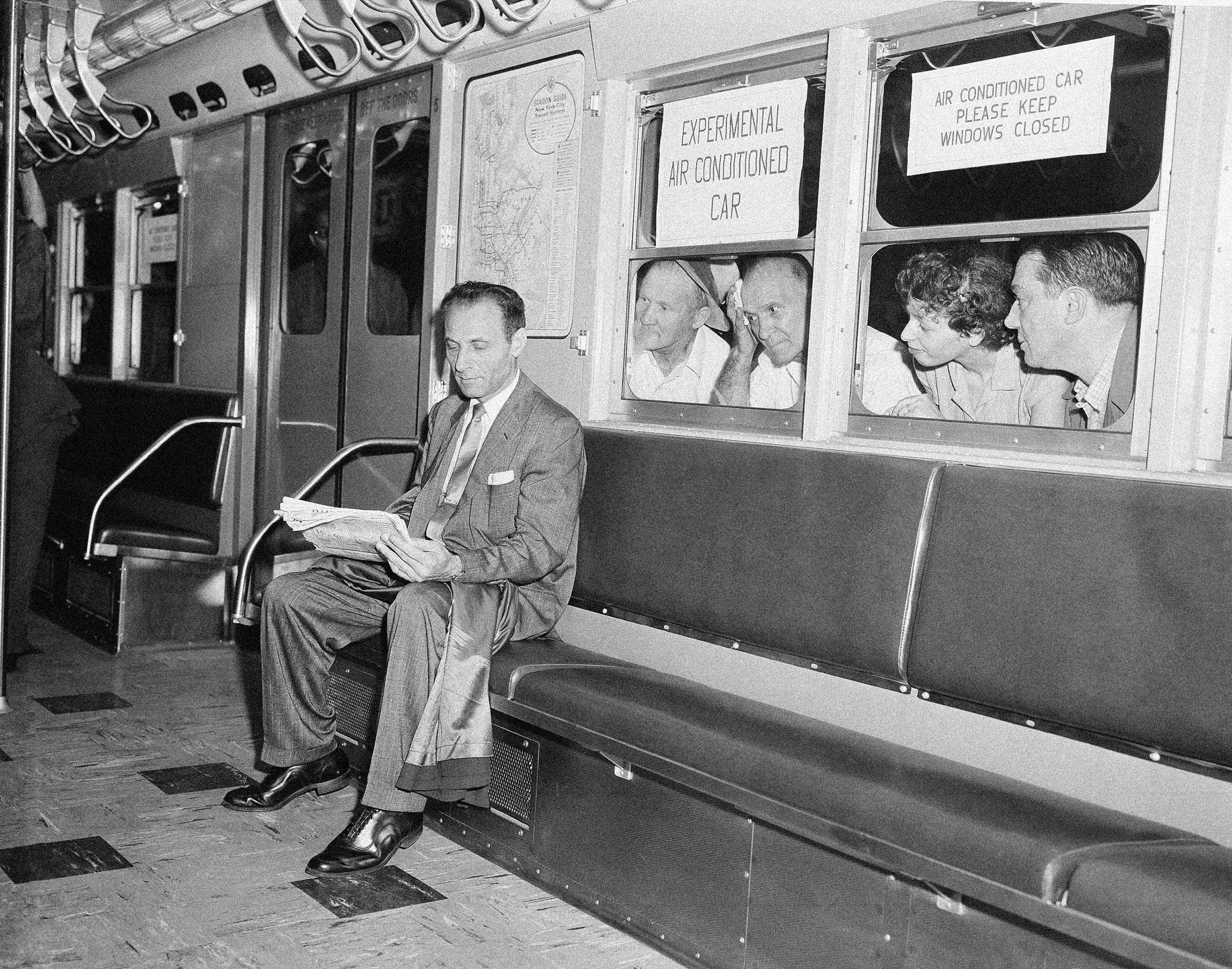 While other subway passengers perspire in the warm and humid underground station, Paul Forman appears cool and comfortable in the experimental air conditioned train, which made its first run in New York City, in July 1956. The test run included six air conditioned cars and two old cars. When the train left Grand Central Station, the temperature was 89 degrees in the old cars, while the new cars registered a temperature of 76.5 degrees.