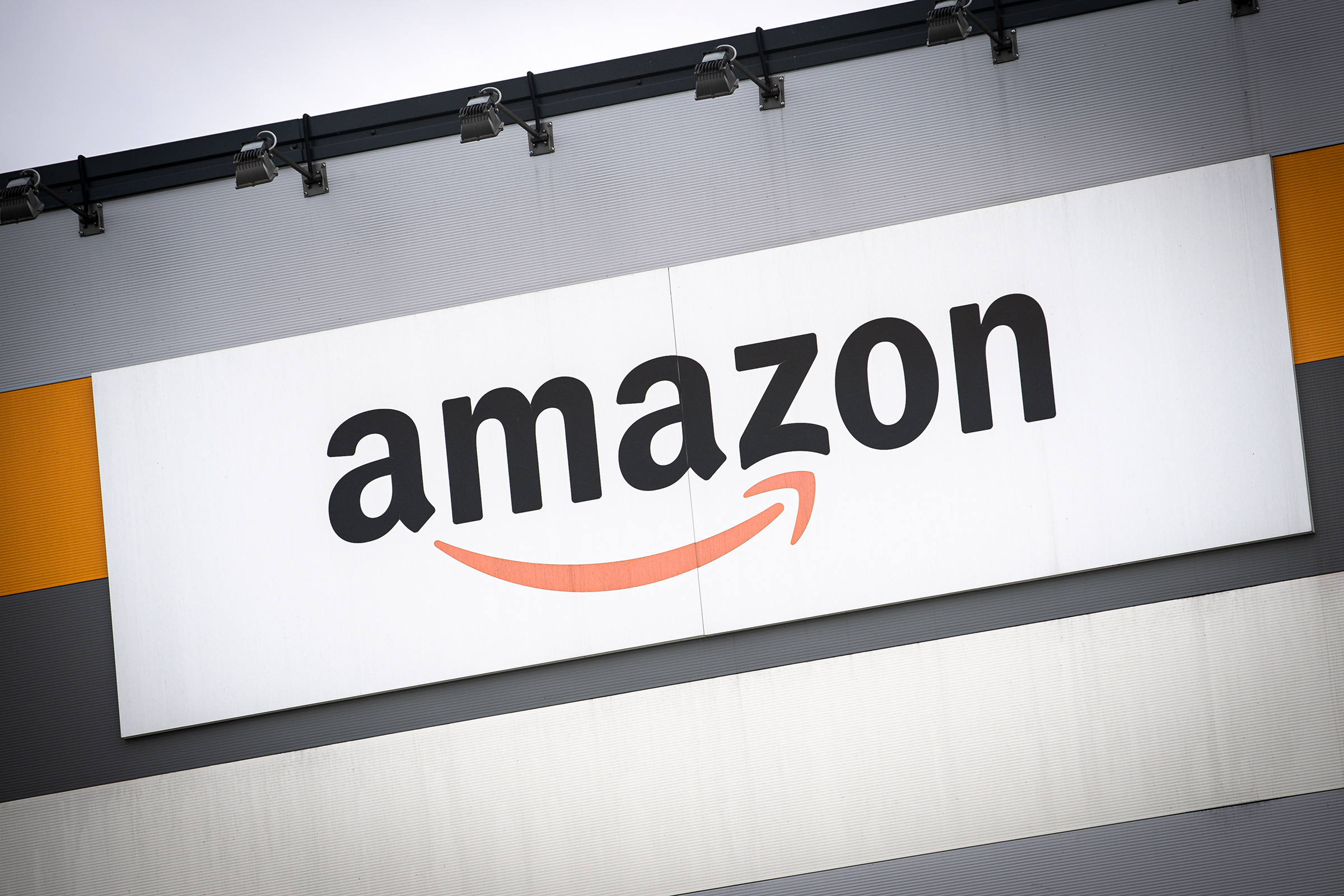Amazon's logo is seen outside a distribution centre during a demonstration for better working conditions in front of the Amazon distribution centre in Brandizzo on March 22.