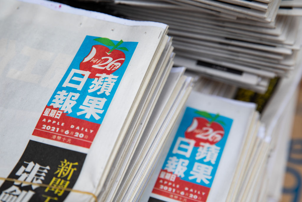 Copies of Next Digital's Apple Daily newspaper at a news stand on its 26th anniversary in Hong Kong, China on Sunday, June 20, 2021. Hong Kong's pro-democracyApple Dailyhas enough cash on hand to continue operating as normal only for a couple of weeks, according to a person familiar, after authorities used a sweeping national security law to freeze company assets and arrest top editors and executives.