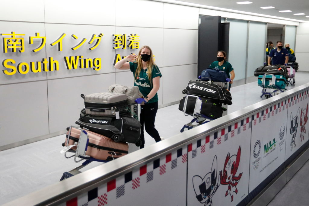 Members of Australia's Olympic softball team, the first national team to come to Japan for pre-Olympic training camp since the Tokyo 2020 Olympic Games were postponed to 2021 due to COVID-19, arrive at Narita International Airport in Narita, east of Tokyo, on June 1, 2021.