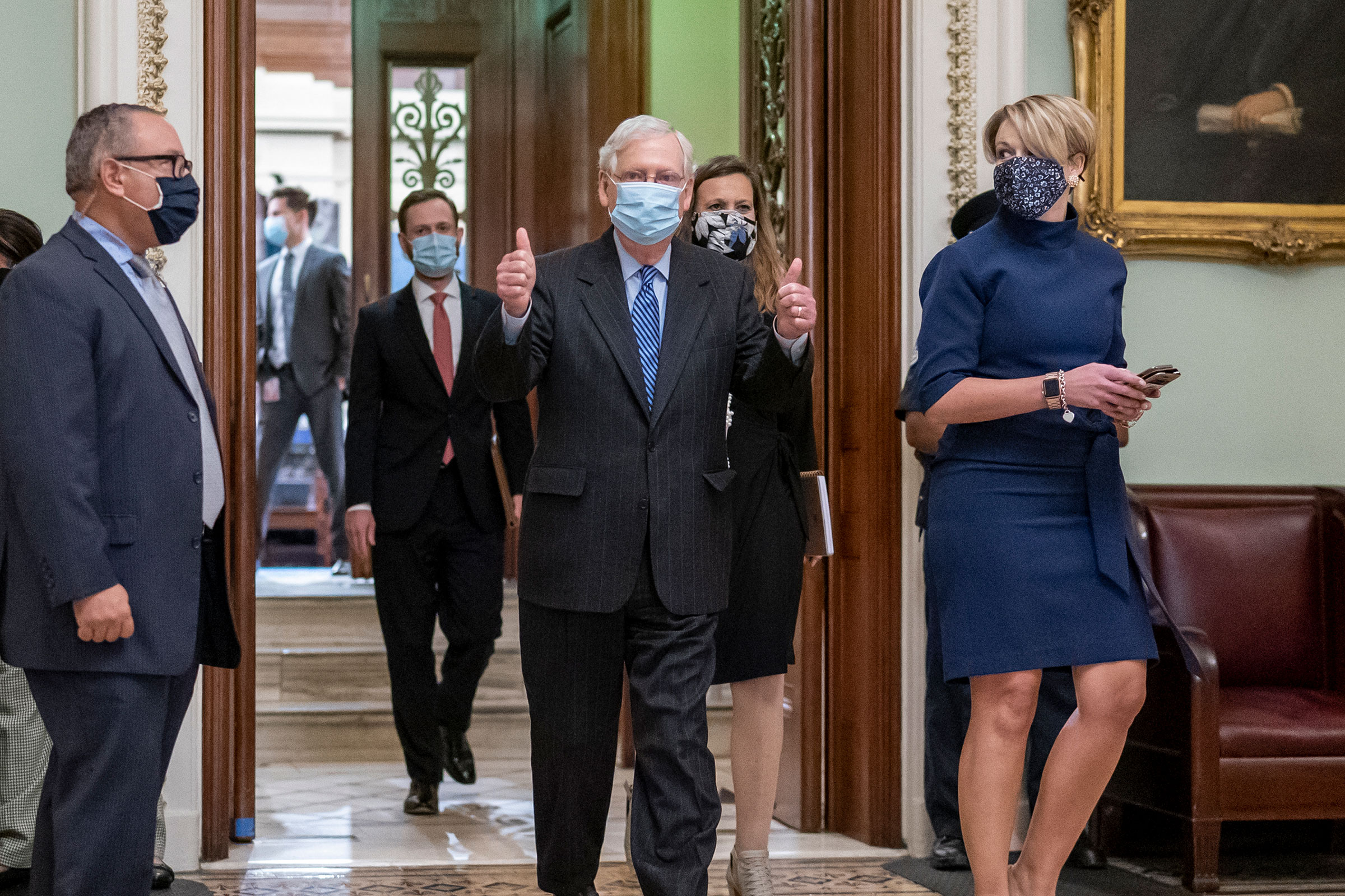 Mitch McConnell leaves the chamber after final roll call vote to put Amy Coney Barrett on the Supreme Court, at the Capitol in Washington, Monday, Oct. 26, 2020.