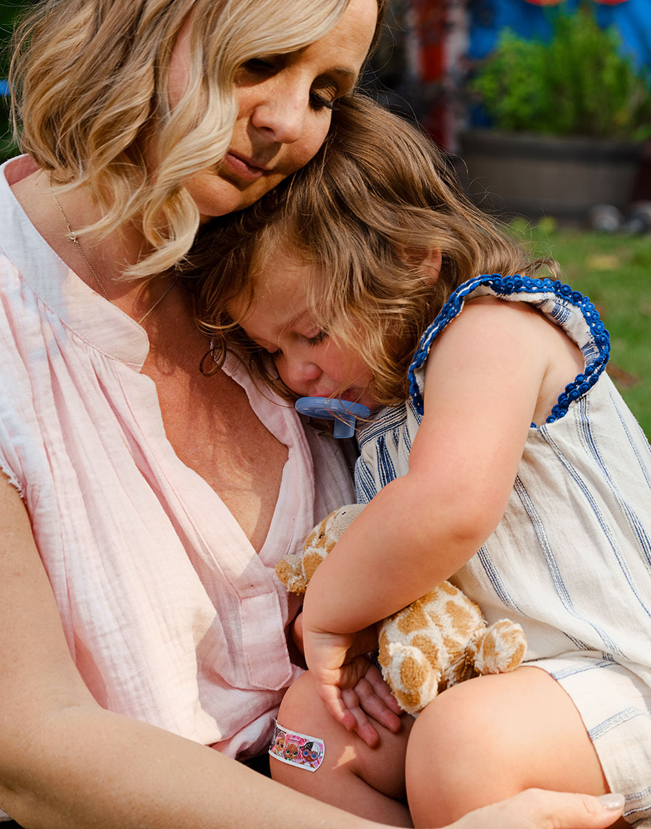 Aubrey Sabala, who follows Dr. Becky's parenting advice, cuddles her daughter in Atlanta on May 25.