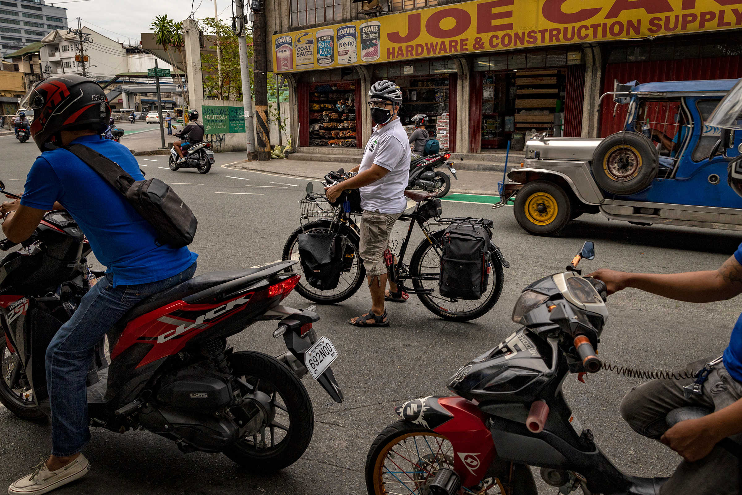 Dr. Alejandro Umali, a physician working at a private hospital, rides his bike to work in Pasig, Metro Manila, on April 26. Many Filipinos, including health care workers, are hopping on bicycles as an alternative means of transportation as public transit remains restricted during the world's longest COVID-19 lockdown.