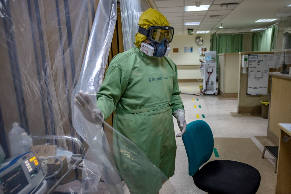 Dr. Alejandro Umali wears personal protective equipment inside the COVID-19 ward of The Medical City, a private hospital, in Pasig, Metro Manila, on April 26.