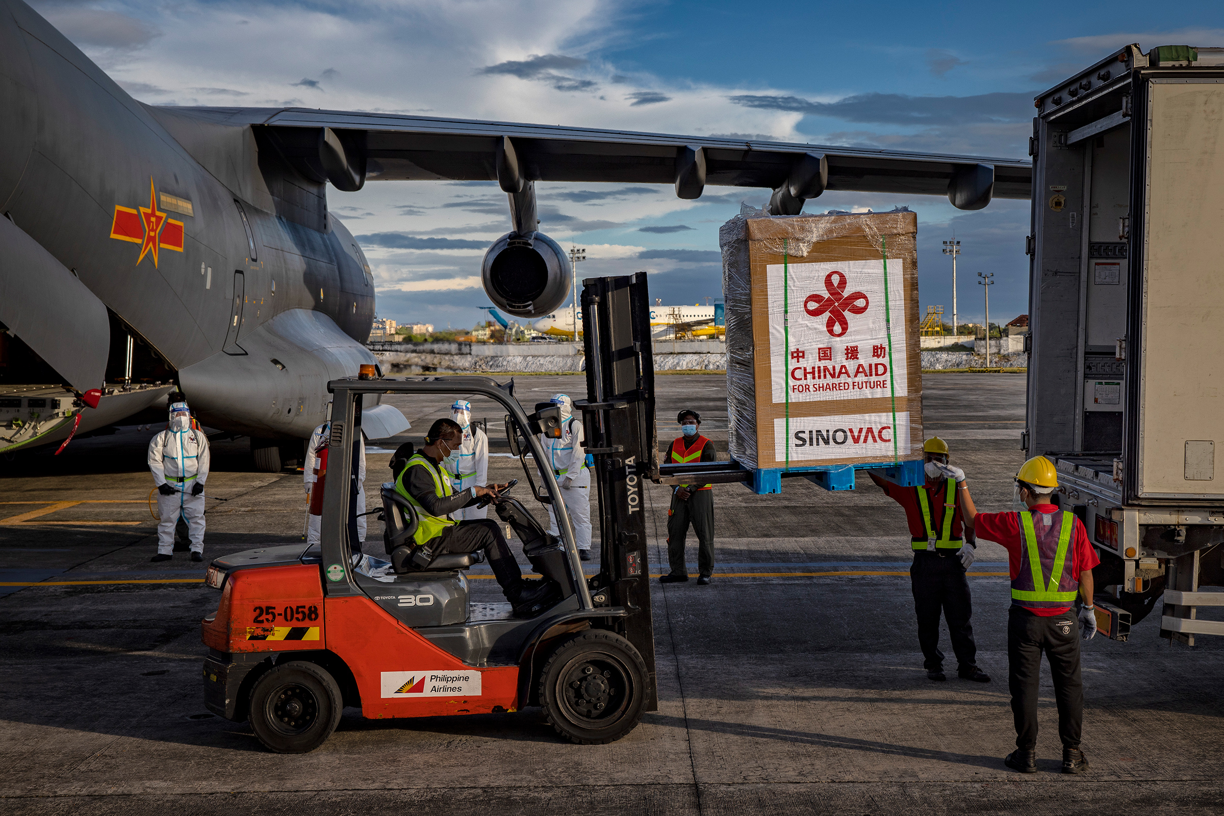 A crate containing Sinovac Biotech COVID-19 vaccines is loaded into a truck upon arrival at Ninoy Aquino International Airport in Manila on Feb. 28. Duterte witnessed the arrival of 600,000 doses donated by the Chinese government.