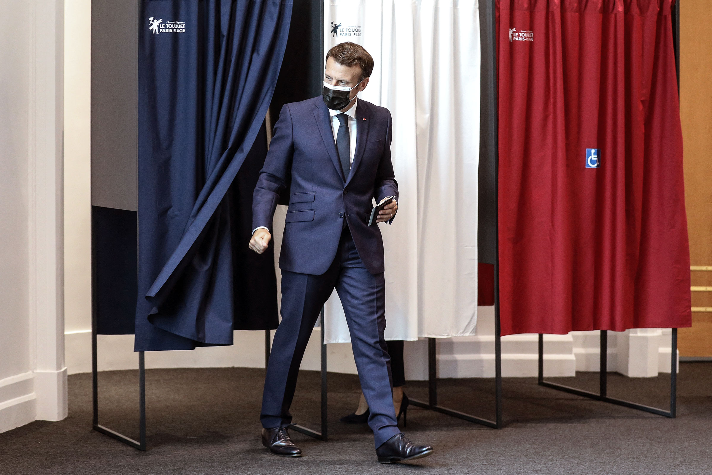French President Emmanuel Macron and his wife Brigitte Macron vote at the polling station in Le Touquet, France, for the first round of the French regional and departmental elections on June 20, 2021.