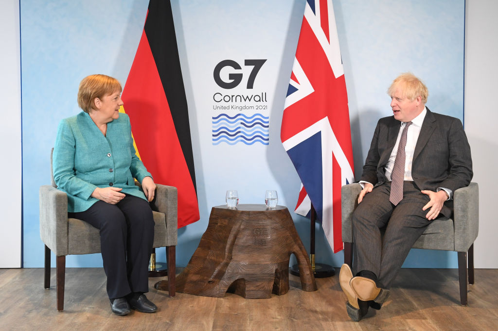 Prime Minister Boris Johnson (right) greets German Chancellor Angela Merkel, ahead of a bilateral meeting during the G7 summit in Carbis Bay, during the G7 summit on June 12, 2021 in Carbis Bay, Cornwall.