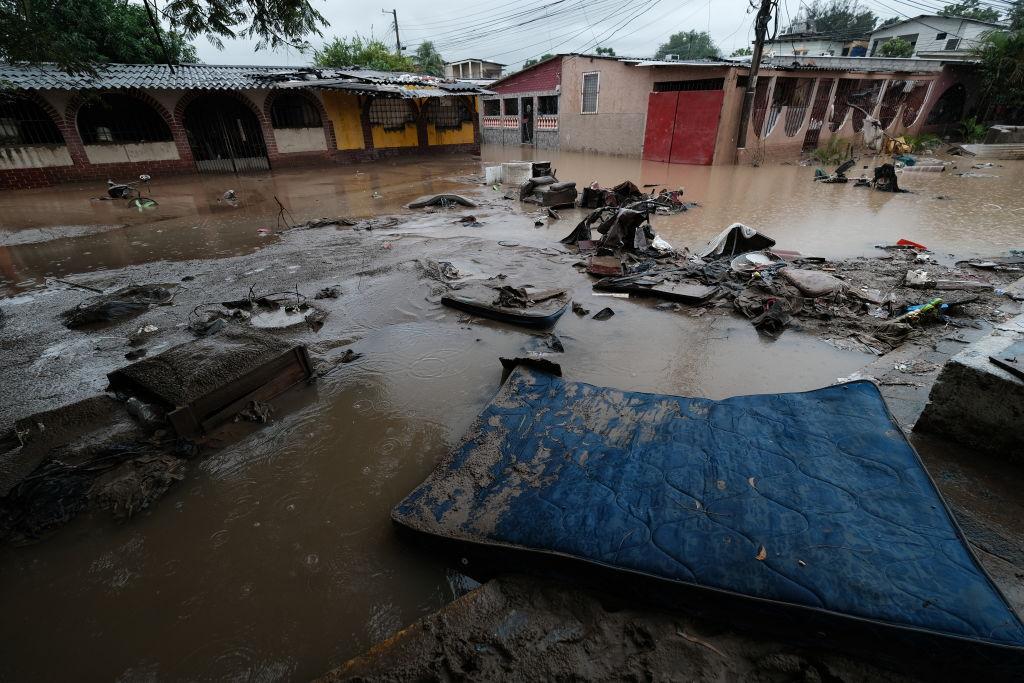 A street covered in mud, debris and the neighbors' belongings that were swept away by Hurricane Iota flooding in San Pedro Sula, Honduras, on Nov. 21, 2020.