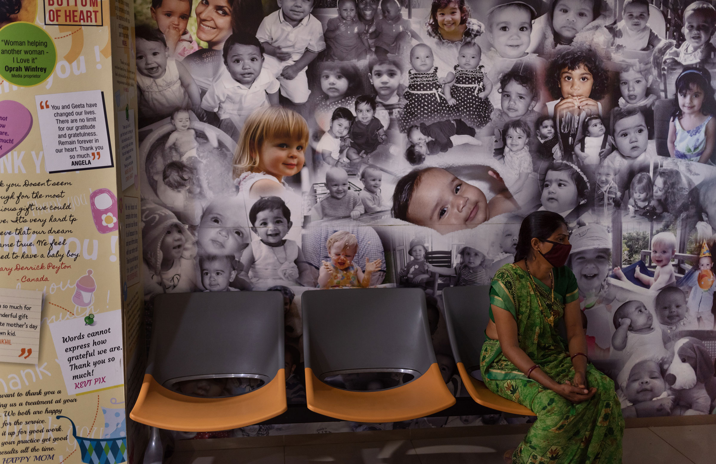 Posters of babies born through surrogacy decorate the walls of the reception area of the Akanksha Hospital.