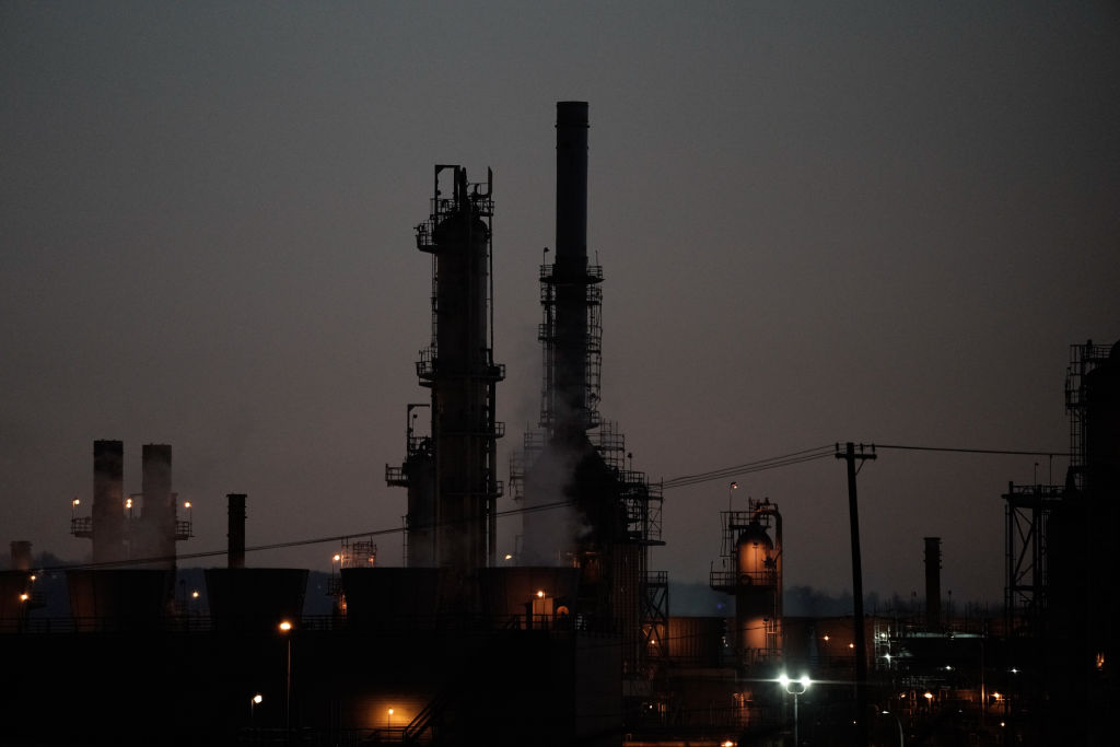 Distillation towers stand at dusk at the Marathon Petroleum Corp. Los Angeles Refinery in Wilmington, California, U.S., on Tuesday, April 21, 2020. American crude surged above $13 a barrel after President Donald Trump ordered the navy todestroyany Iranian gun boats that harass American ships at sea.