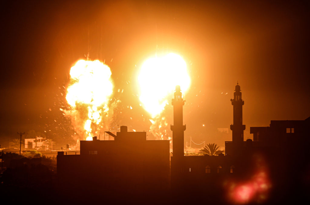 Flames are seen after an Israeli air strike hit Hamas targets in Gaza City, Gaza on June 15, 2021.