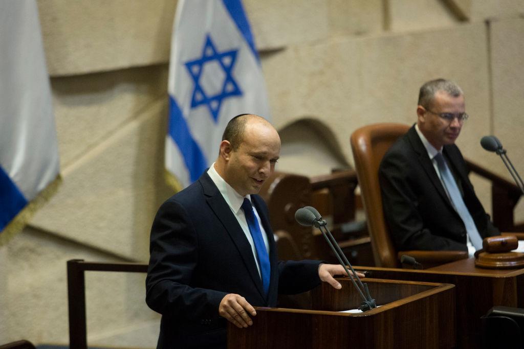 Desingated Israeli Prime Minister Naftali Bennett speaks before the parliament voted on a new government on June 13, 2021 in Jerusalem, Israel.