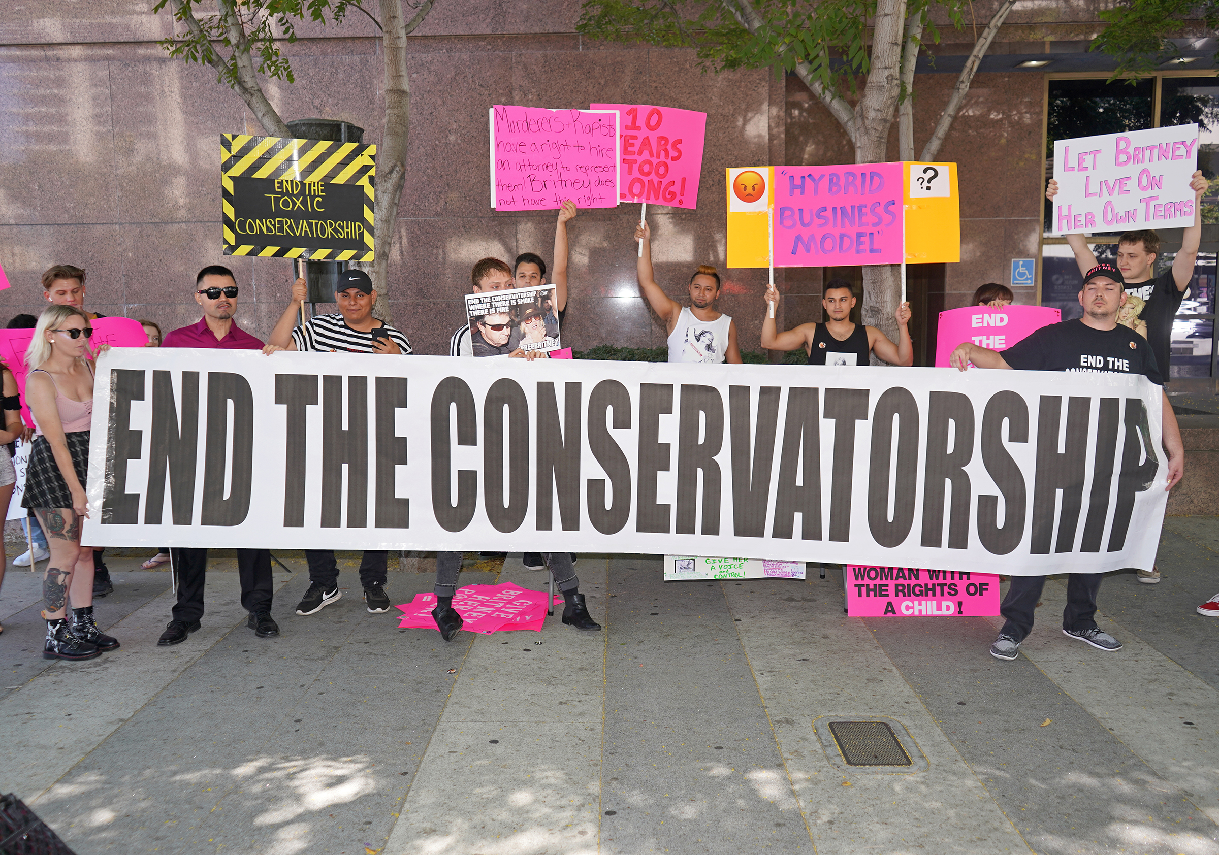 Protesters hold a banner outside a conservatorship hearing in September 2019.