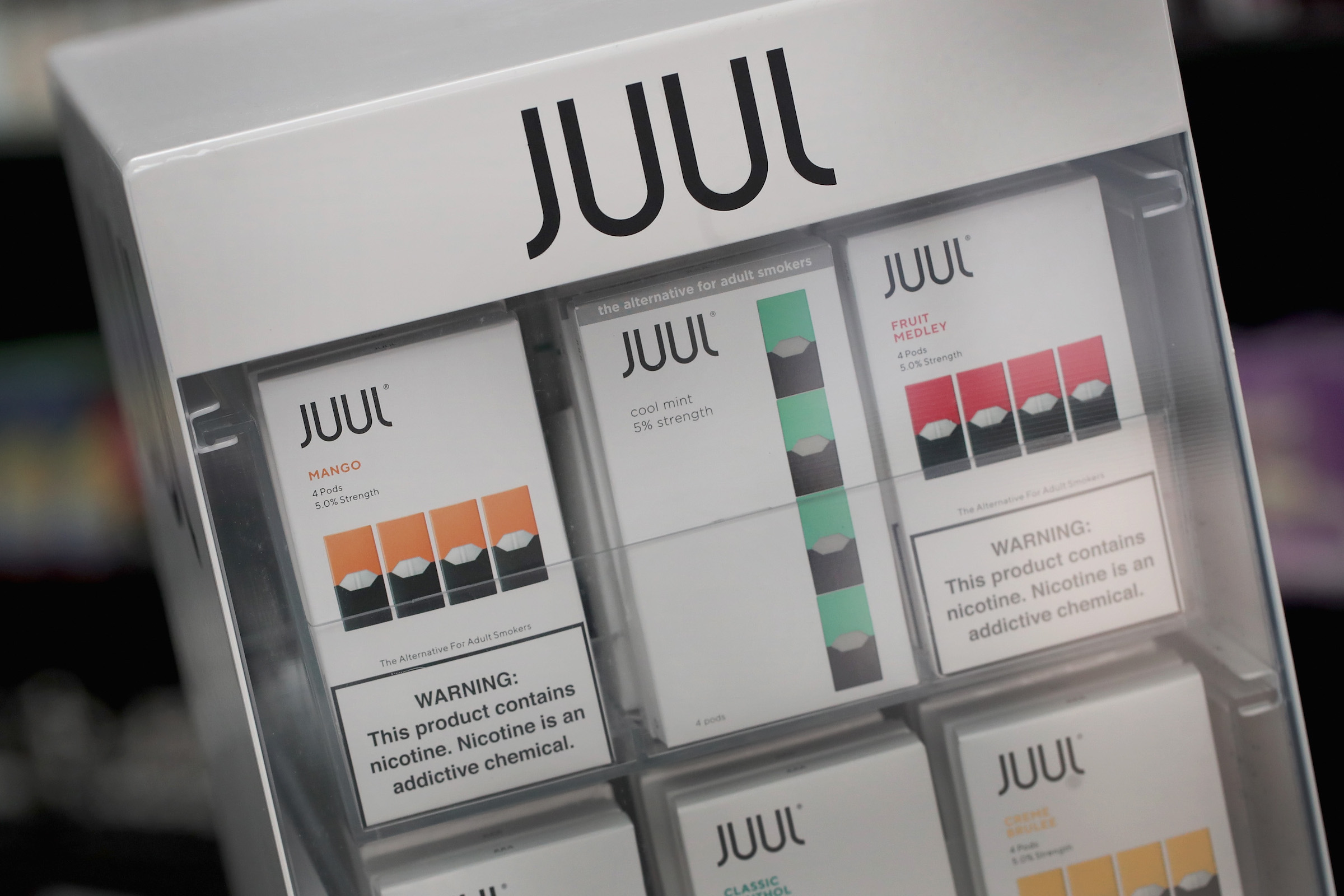 Electronic cigarettes and pods by Juul, the nation's largest maker of vaping products, are offered for sale at the Smoke Depot on September 13, 2018 in Chicago, Ill.