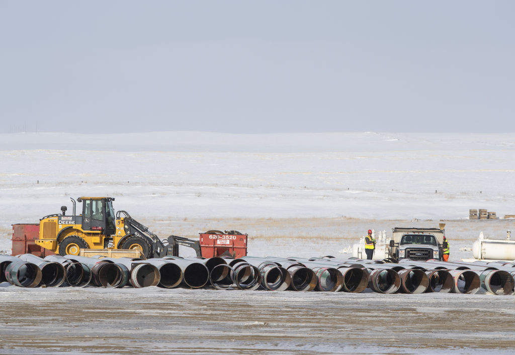 Workers load a truck with equipment at a pipe yard for the Keystone XL pipeline in Oyen, Alberta, Canada, on Tuesday, Jan. 26, 2021. U.S. President Joe Biden revokedthe permit forTC Energy'sKeystoneXL energy pipeline via executive order hours after his inauguration, the clearest sign yet that constructing a major new pipeline in the U.S. has become an impossible task.