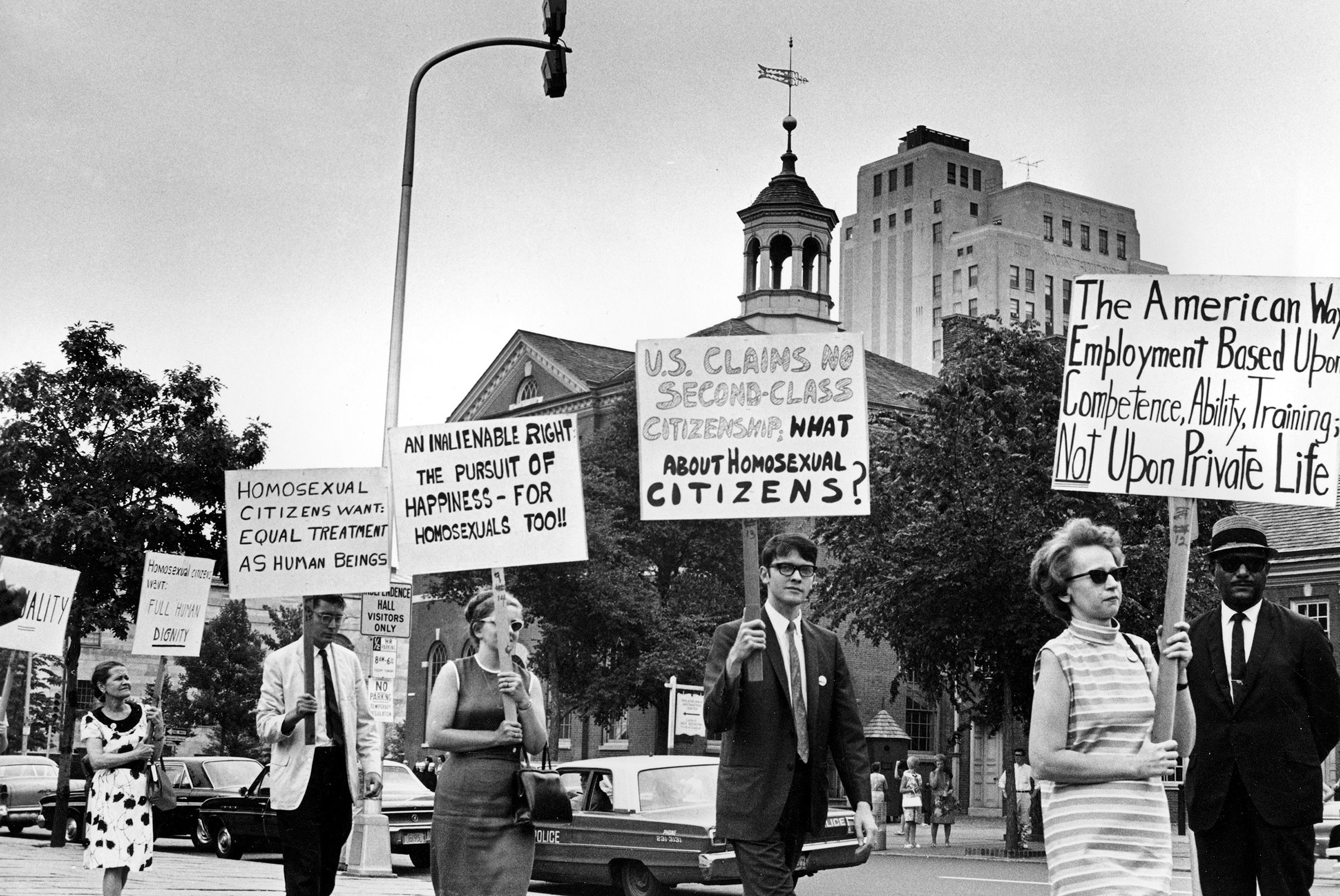 Demonstrators carry signs calling for protection of the LGBTQ community from discrimination as they march in a picket line in front of Independence Hall in Philadelphia on July 4, 1967.