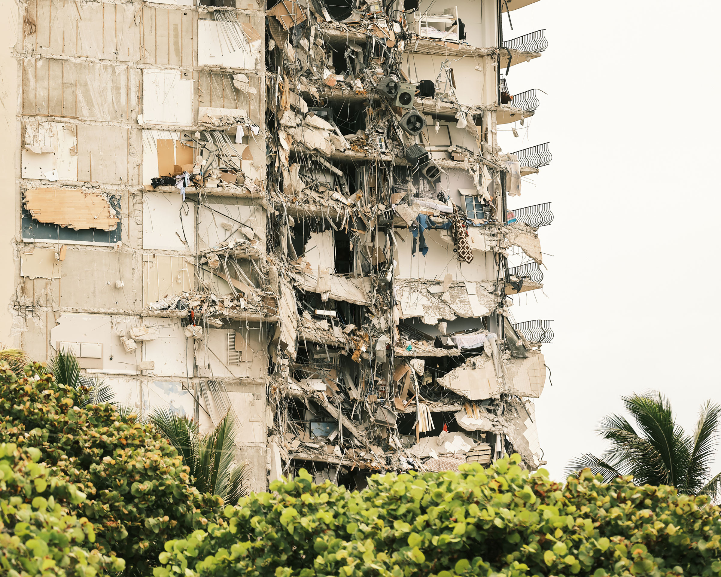 The interior of the Champlain Towers South building is exposed after the residential building partially collapsed in Surfside, Fla. on June 24, 2021.