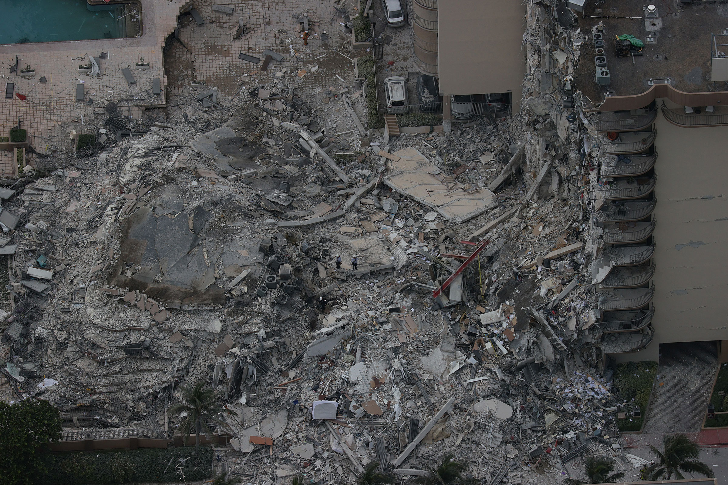 Search and rescue personnel work in the rubble of the 12-story condo tower that crumbled to the ground in Surfside on June 24, 2021.