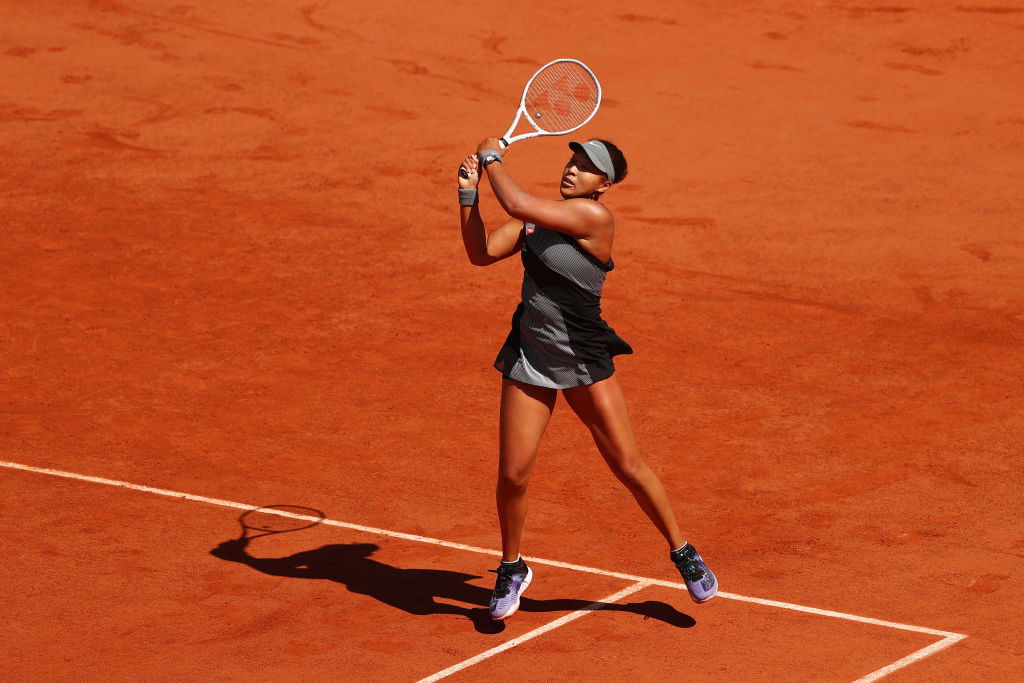 Naomi Osaka of Japan plays a backhand in her First Round match against Patricia Maria Tig of Romania during Day One of the 2021 French Open at Roland Garros on May 30, 2021 in Paris, France.