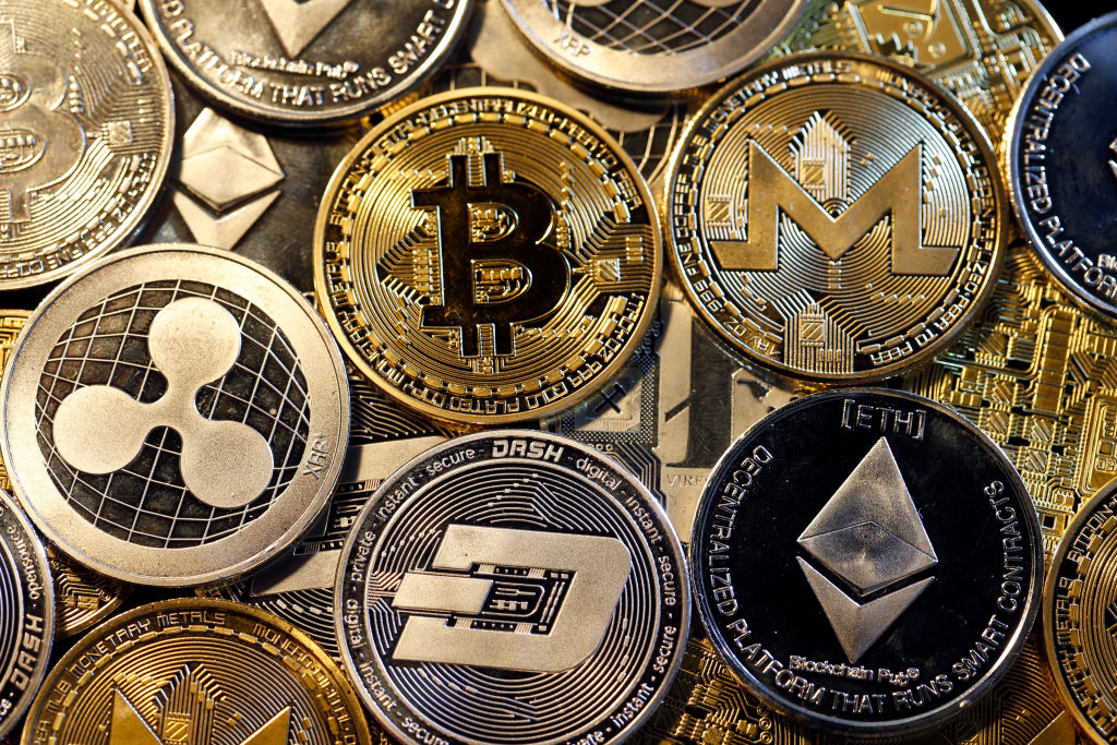 In this photo illustration, a visual representation of digital cryptocurrencies, Bitcoin, Ripple, Ethernum, Dash, Monero and Litecoin is displayed on February 16, 2018 in Paris, France.
